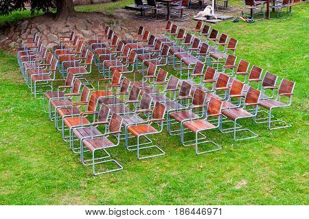 empty wooden metal chairs of an open air garden theater