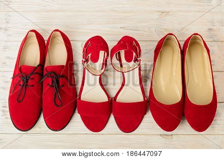 Women's shoes (sandals ballet flats oxfords) red color. Selective focus.