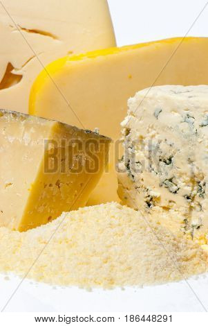Heap of grated cheese isolated on white