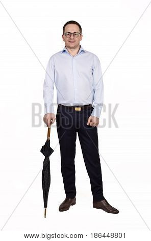 Full Length Portrait Of Young Prosperous Businessman Dressed In Shirt And Trousers Standing On A Whi