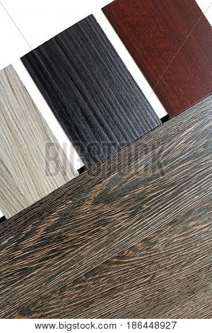 Color swatches of countertops and particle Board.