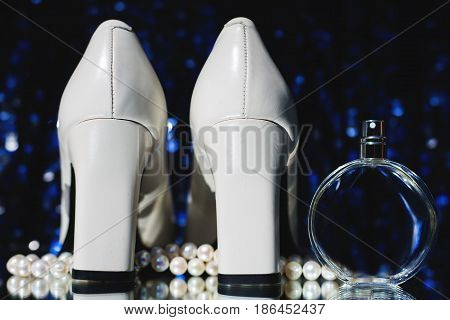 Wedding accessories: perfume bottle with shoes and earrings