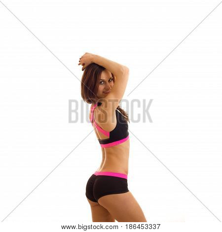 square of cutie young sports girl posing and smiling on camera isolated on white background