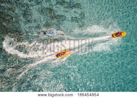 Top view of Banana boat playing and diving in Koh Larn Pataya city Chonburi.