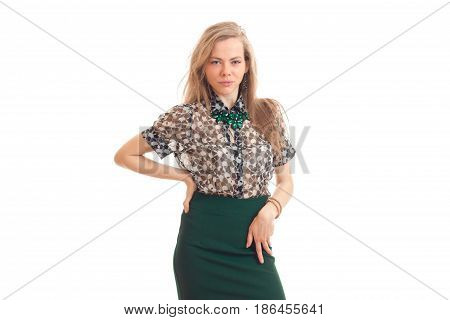 Cutie young blonde business lady with hand on her hip looking at the camera isolated on white background