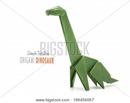 Isolated origami paper green dinosaur on white background
