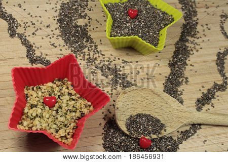 Chia and hemp seeds/ These are a chia and hemp seeds in  star bowls.