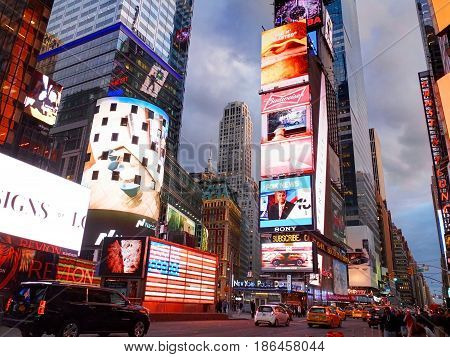 NEW YORK CITY MANHATTAN APR24 2015: Evening view on NYC Times Square lights screens buildings fashion boutiques architecture and advertising led screens Sightseeing holidays vacation tours trips