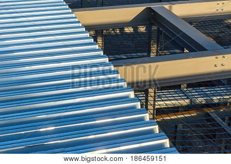 A construction site with I-beam steel framing and steel decking on top
