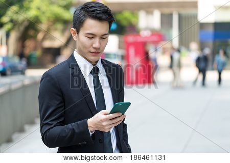 Businessman use of mobile phone