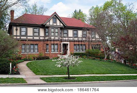 Massive English Tudor Home with Spring Landscape