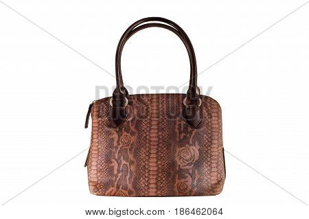 Vintage brown leather handbag in reptile leather with pattern, old fashion bag