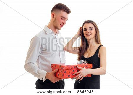 young tall guy brought a beautiful girl in a red gift box isolated on white background