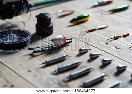 Fishing equipment on the wooden background. Still-life and objects.