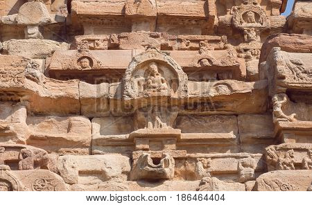 Indian design of stone relief on 7th century temples in Pattadakal of Karnataka, India. UNESCO World Heritage site with stone carved temples.