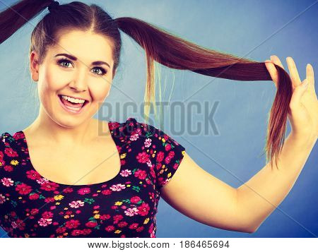 Education teenage adolescence happiness concept. Happy teenager student girl with ponytails having fun