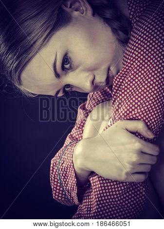 Sad Depressed Girl Sitting Huddled