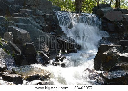 A small waterfall in the park during spring