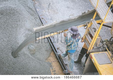 construction worker pouring concrete from cement truck vintage photo