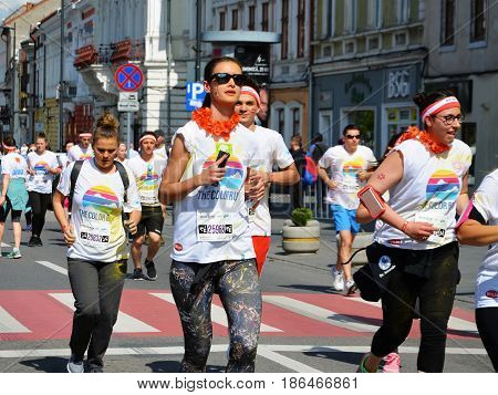 CLUJ-NAPOCA ROMANIA - May 14 2017: Happy people of all ages run on the streets at the Color Run course