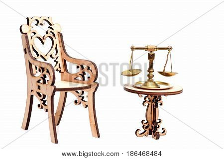 Decorative Wooden Chair With Golden Or Middling Scales On Table