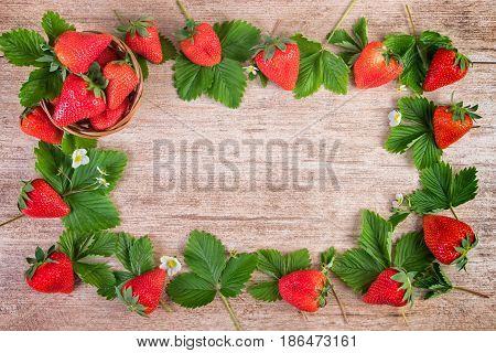 Strawberry bright background frame of ripe strawberries