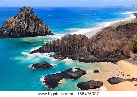 Aerial view of beach Baia dos Porcos and natural pools on tropical island Fernando de Noronha Brazil