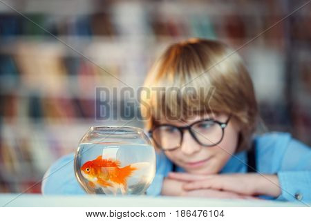 Smiling child with goldfish