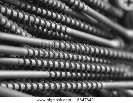industrial Background with the black metall screw.