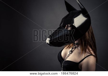 sexy slave woman in dog mask isolated on gray background
