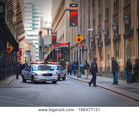 NEW YORK TIMES SQUARE, APR,24, 2015: NYPD New York Police Department closed off blocked New York street for movie making crew. No entrance for not authorized people
