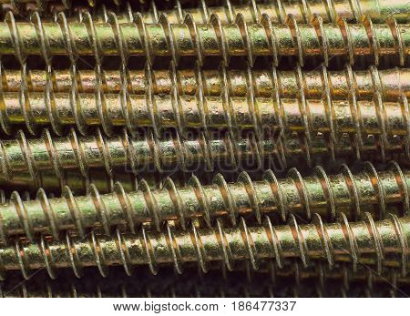 closeup industrial Background with the gold metall screw.