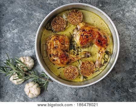close up of rustic italian roast chicken with garlic and rosemary