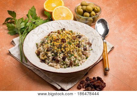 barley risotto with dried grape green olives and grated orange peel