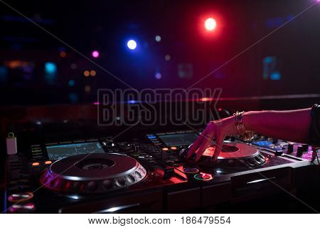 Female hands with a dj mixer