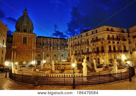 Famous baroque Fountain of shame on Piazza Pretoria at night Palermo Sicily Italy Europe