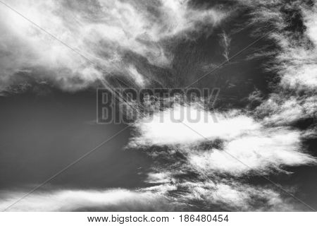 Cloudscape background of black and white dramatic monochrome cirrus clouds