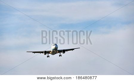 Plane At The Sky Background
