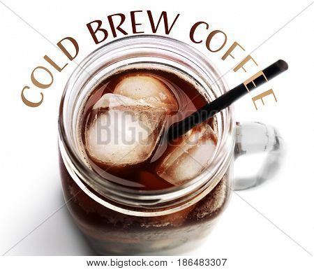 Glass jar of cold brewed coffee on white background