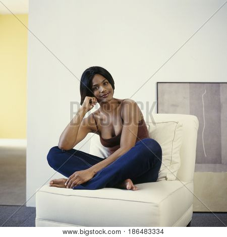 Smiling woman sitting in chair