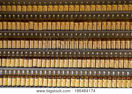 Hua Hin, Thailand - April 01,2017: Old Thai Whiskey Bottle Arranged And Decorate On Shelf Wall As Ba