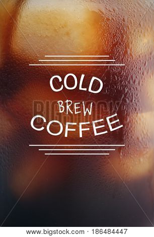 Text COLD BREW COFFEE on steamed glass background