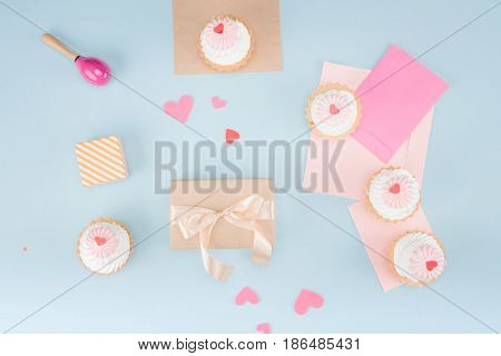 Top View Of Cakes With Gift Box And Beanbag With Blank Notes Mock-up, Birthday Party