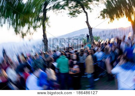 a blurred group of people in a celebration