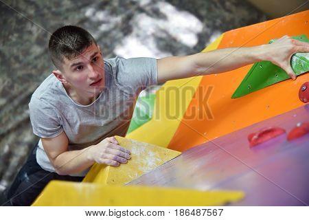Muscular Climber Man Climbing Up