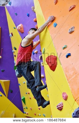 Man Climbing On Wall