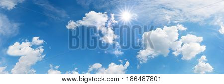 Blue sky in summer with sun and clouds for a background
