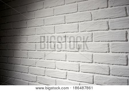 white brick wall with light effect and shadow, abstract background photo, side view