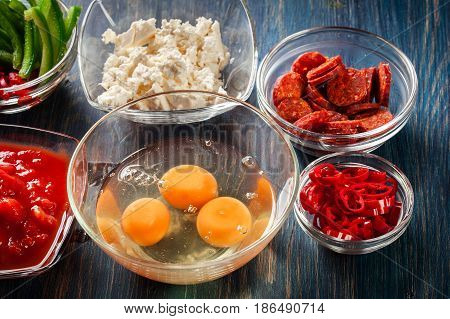 Ingredients For Preparing Frittata - Eggs, Sausage Chorizo, Red Pepper, Green Pepper, Tomatoes, Chil