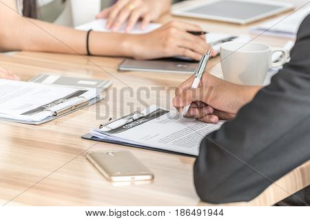 image Business man signing a contract .